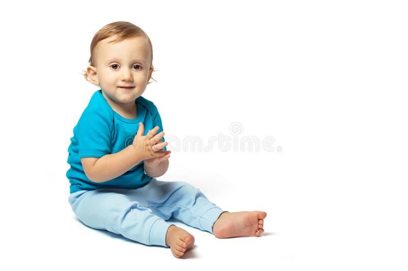 Cute baby boy sitting isolated on the white background royalty free stock photo
