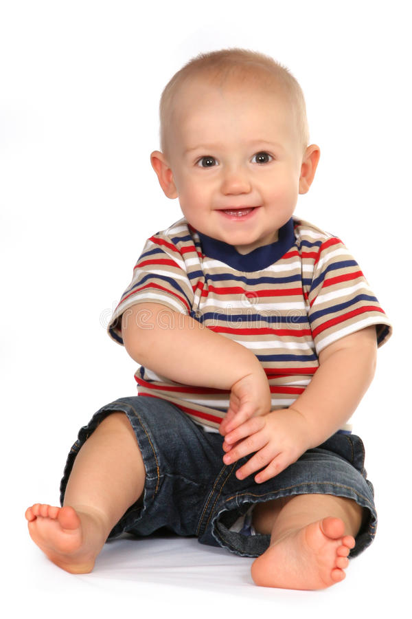 Cute Baby Boy Toddler Sitting and Holding Hand royalty free stock photos