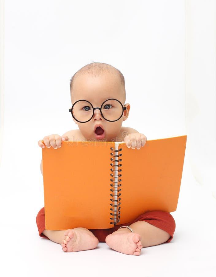 Baby reading book stock photo