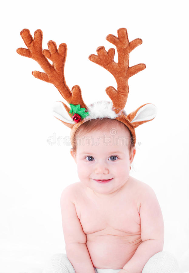 Cute baby Christmas expression stock photography