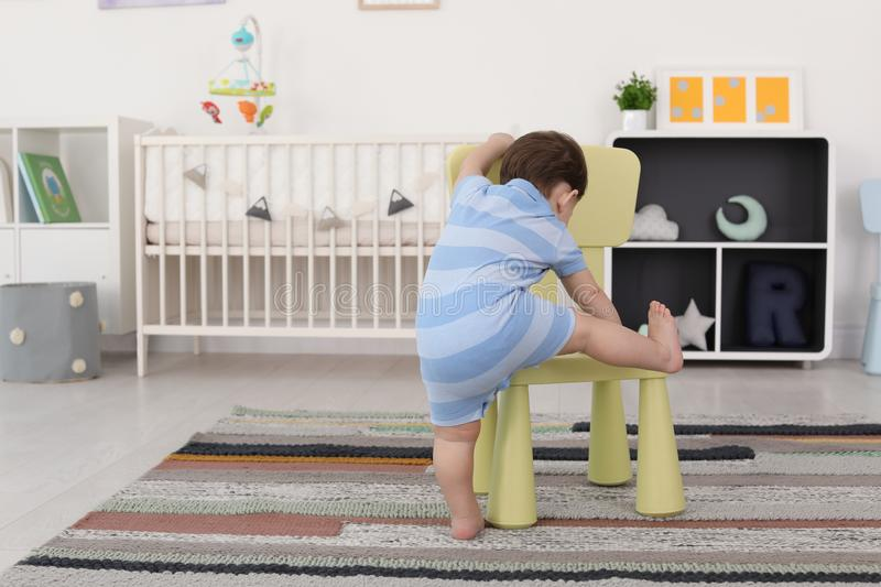 Toddler Climbing On Chair Stock Photo Image Of Baby