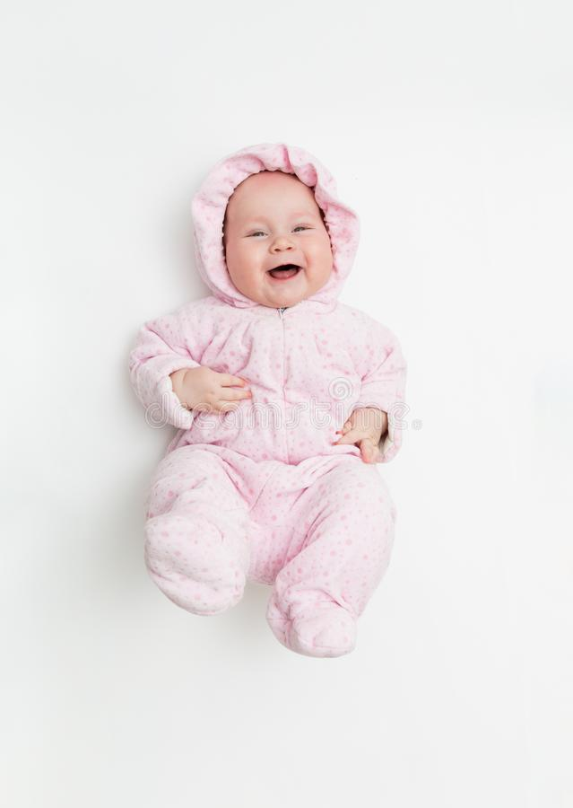 Cute baby dressed in warm overall for winter cold weather. royalty free stock photo