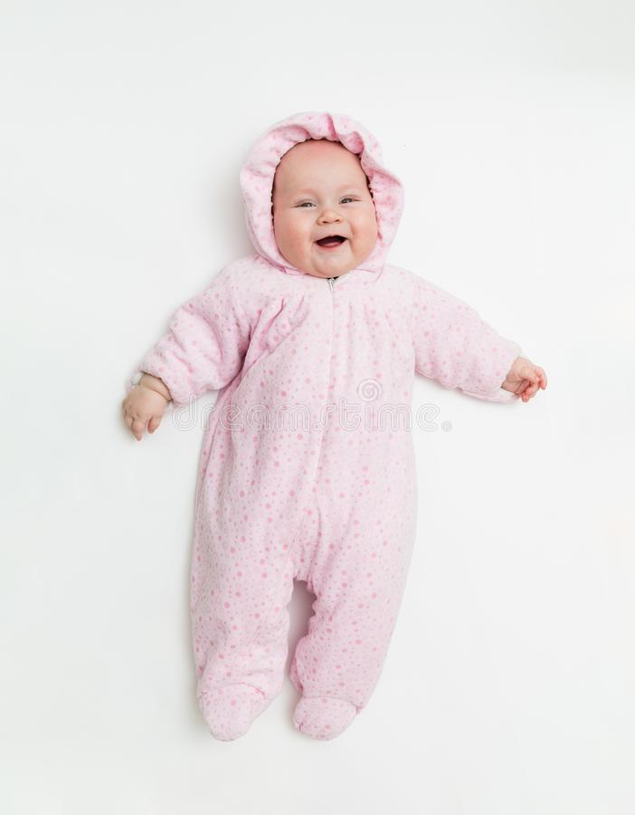 Cute baby dressed in warm overall for winter cold weather. stock photos