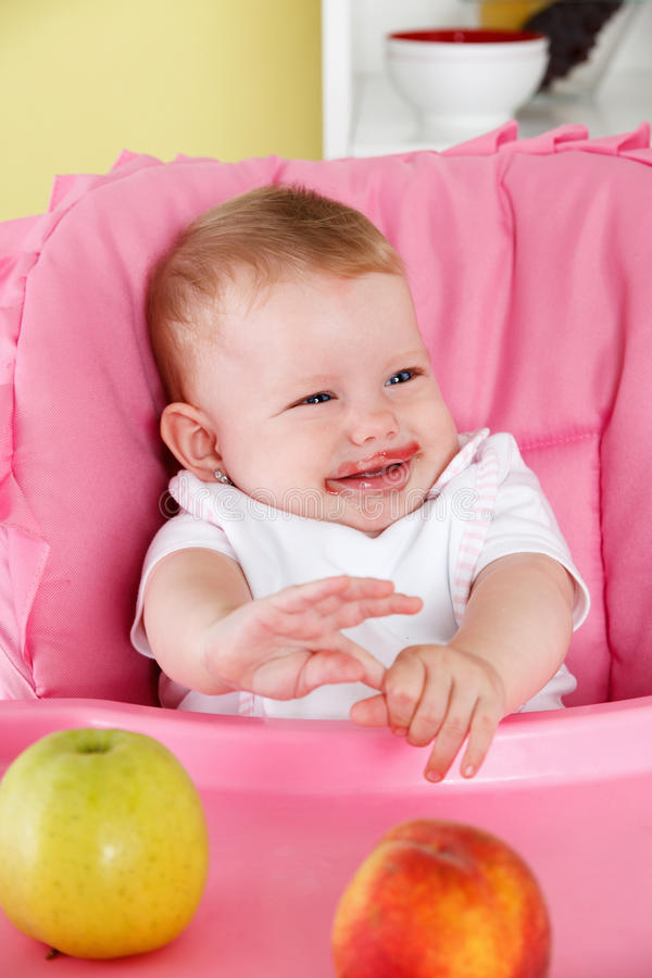Cute baby eating stock photos