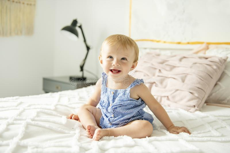 Cute baby girl on bed at home. A Cute baby girl on bed at home stock images