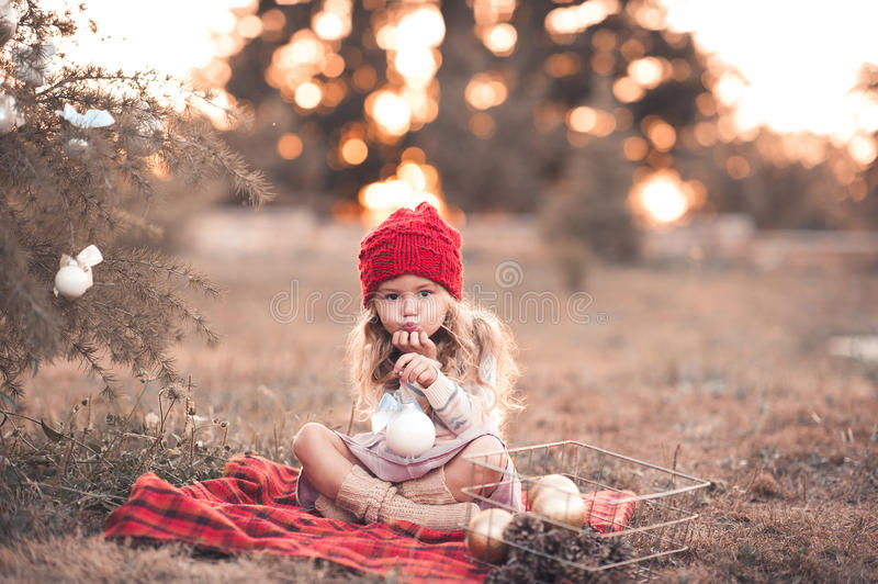 Cute baby girl with christmas decorations stock image