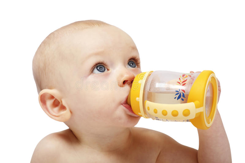 Cute baby girl drinking from bottle with teath royalty free stock images