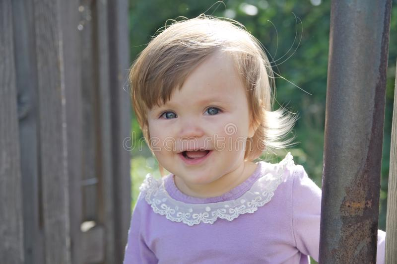 Cute baby girl happy smiling portrait. Adorable emotional child outdoor stock photography