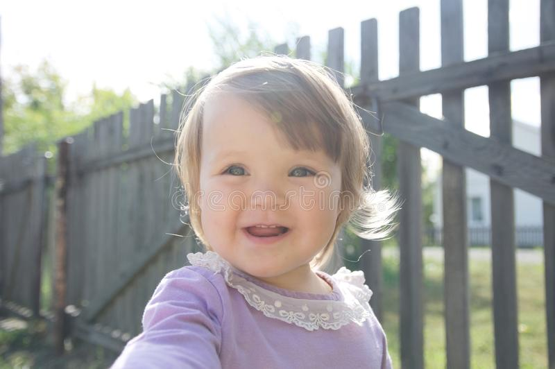 Cute baby girl happy smiling portrait. Adorable emotional child outdoor royalty free stock images