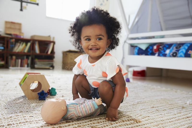 Cute Baby Girl Having Fun In Playroom With Toys stock photos