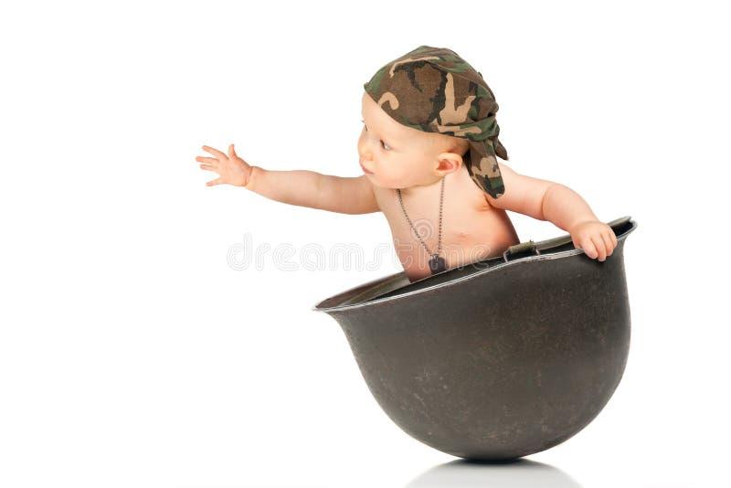 Baby marine inside a military helmet stock photos