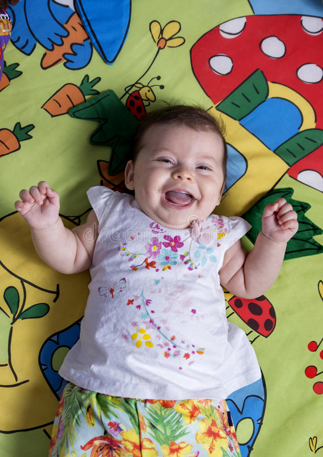 Cute Baby Girl laughing royalty free stock image