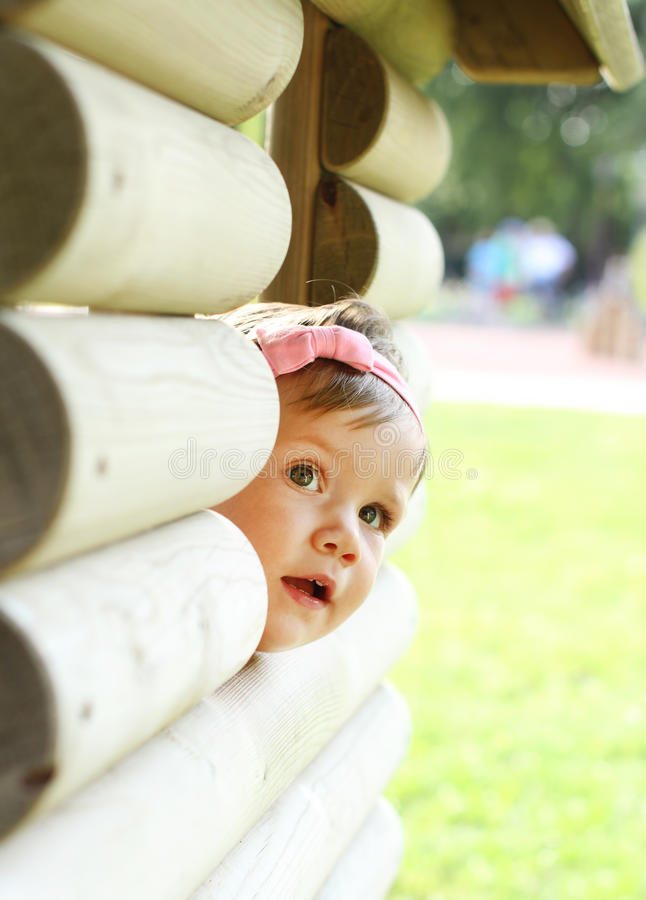 Cute baby girl looking royalty free stock photos