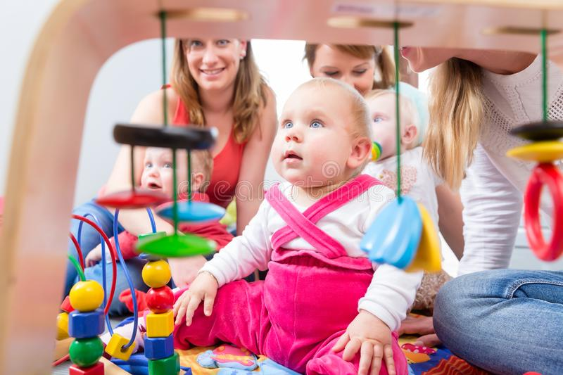 Cute baby girl looking up while sitting down on the floor at home stock photography