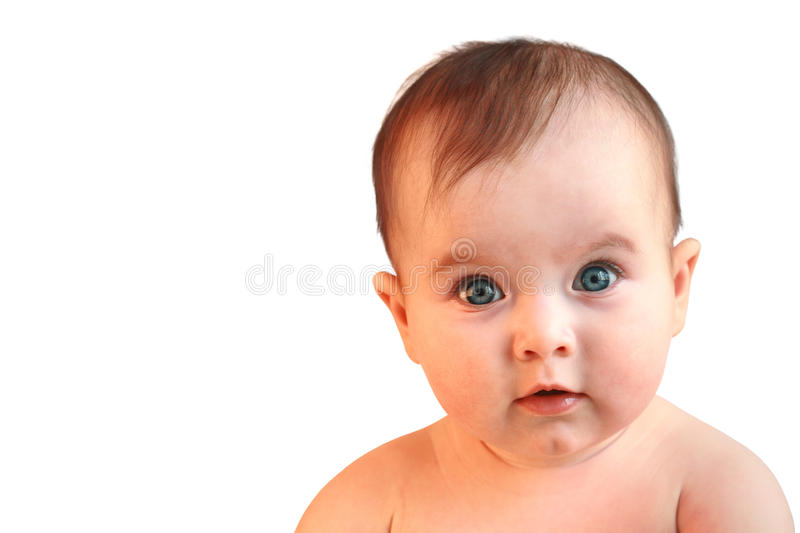 Cute baby girl looking in wide-eyed astonishment royalty free stock photography