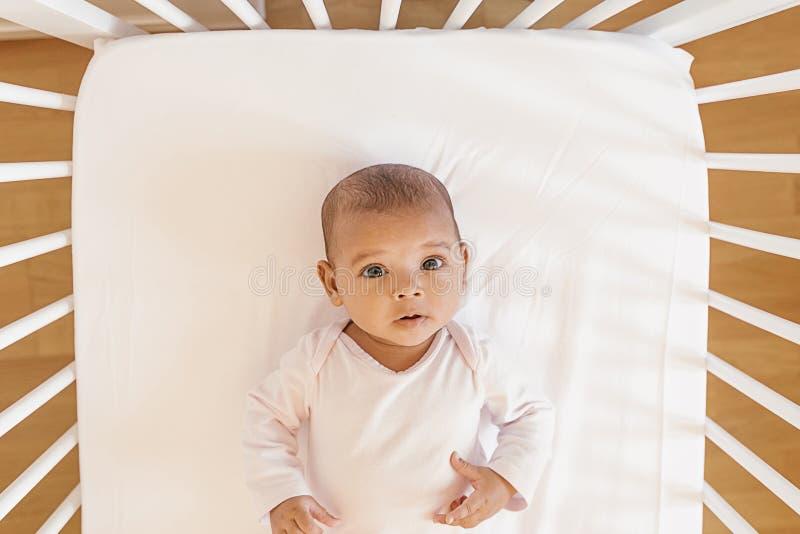 Cute Baby Girl Lying in the Crib stock image
