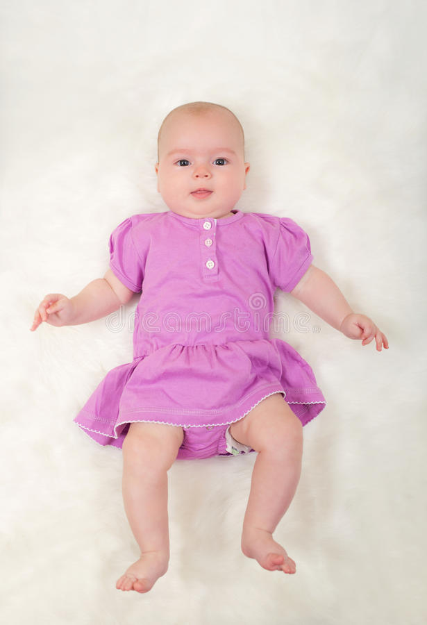 Cute baby girl lying royalty free stock images