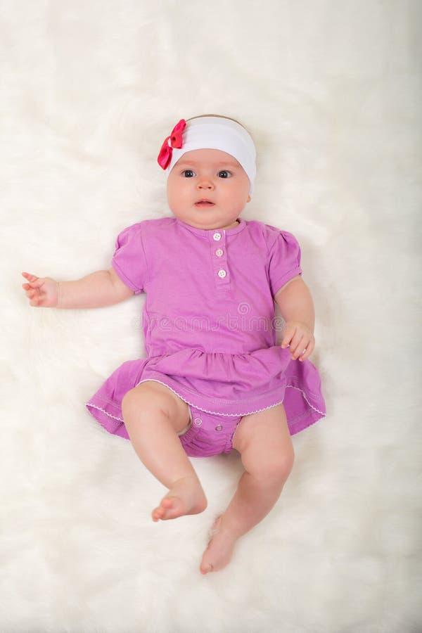Cute baby girl lying stock photos
