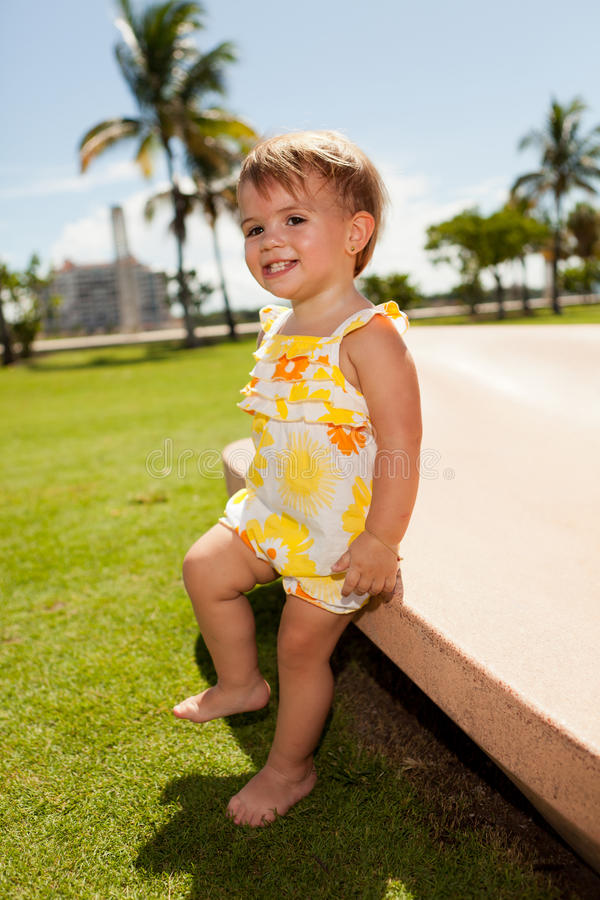 Cute baby girl outdoors stock image