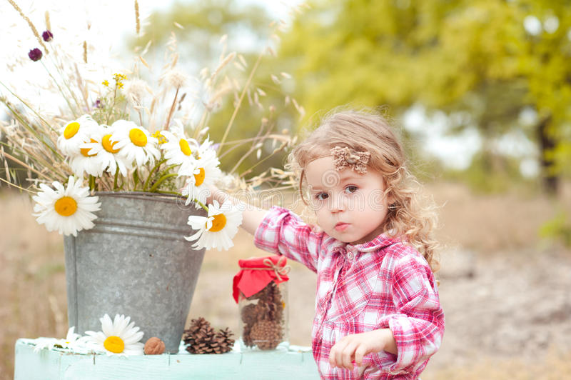 Cute baby girl outdoors royalty free stock images