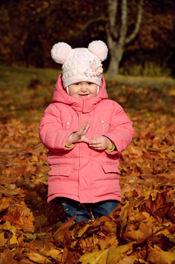 Cute baby girl in park royalty free stock photography