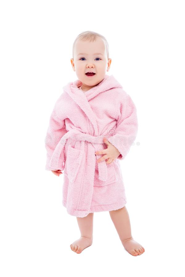 Cute baby girl in pink bathrobe after bath posing isolated on white. Background stock image
