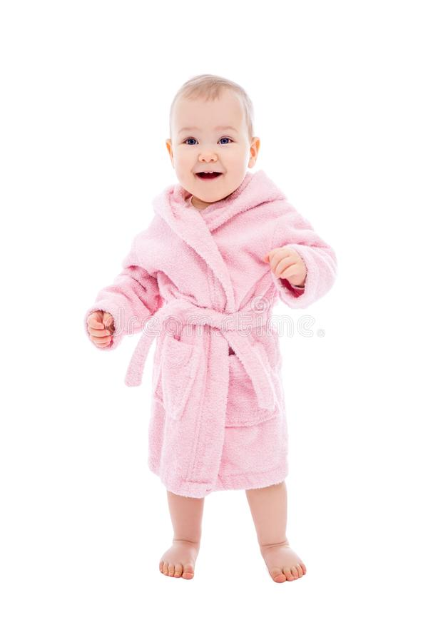 Cute baby girl in pink bathrobe after bath standing isolated on white. Background stock image