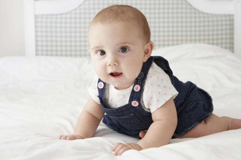 Cute Baby Girl Playing On Bed stock photography