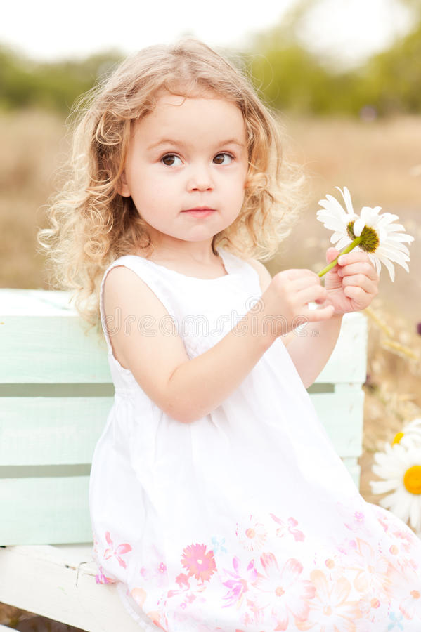 Cute baby girl playing outdoors royalty free stock photos