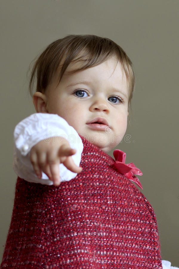 Cute baby girl pointing royalty free stock photography