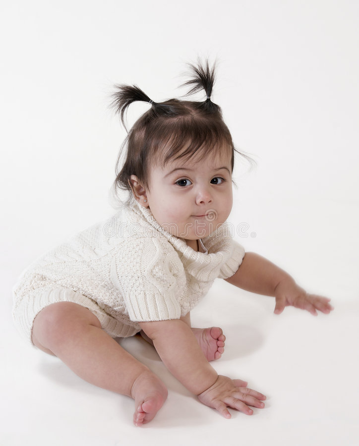 Cute baby girl ready to crawl stock image