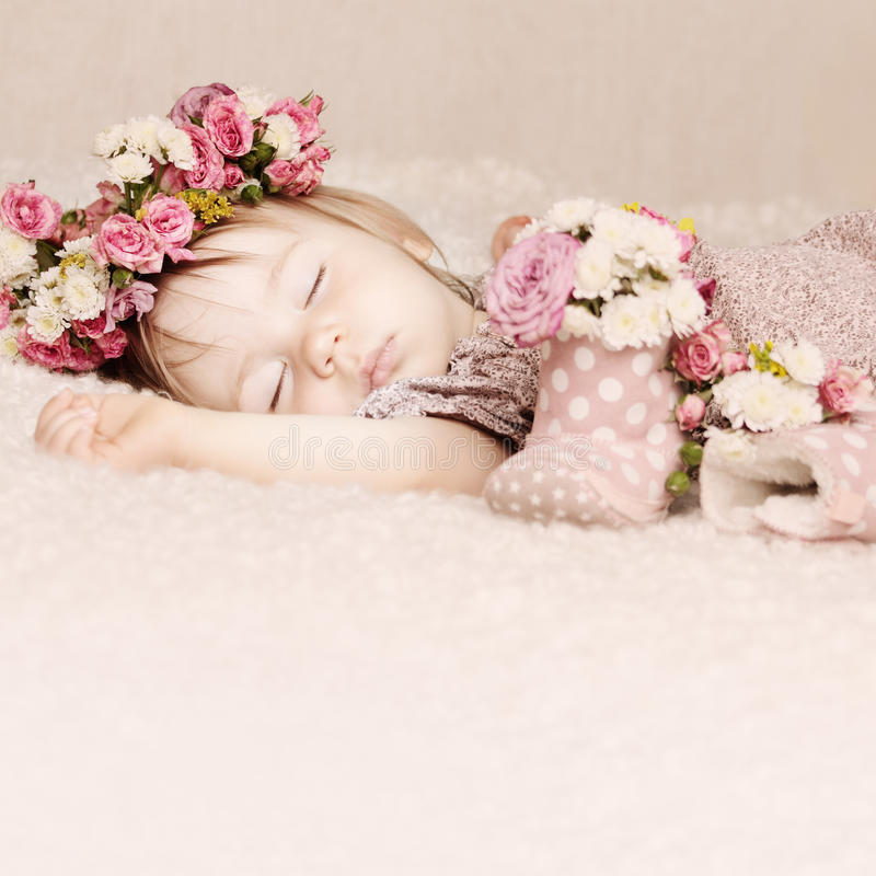 Cute baby girl sleep with flowers vintage royalty free stock image