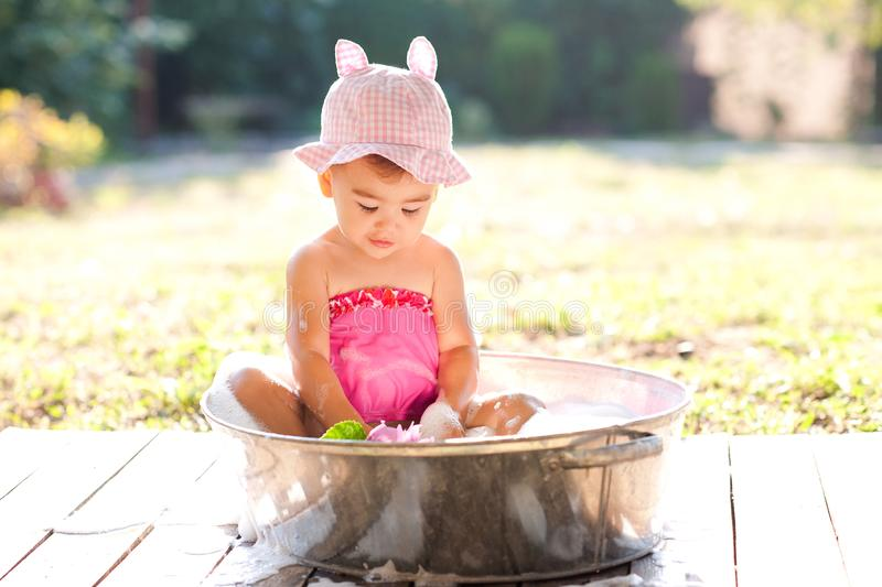 Baby girl outdoors stock photography