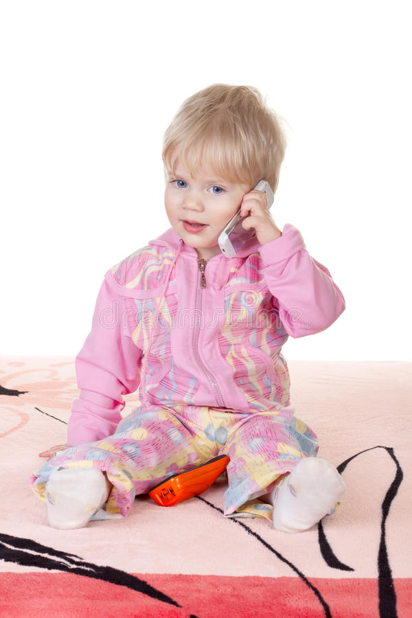 Cute baby girl talking on mobile phone royalty free stock photo