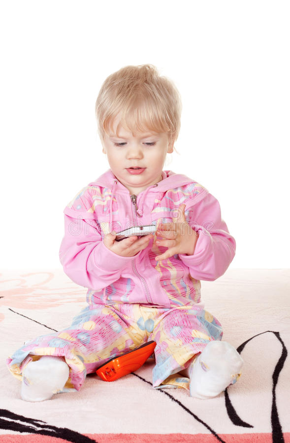 Cute baby girl talking on mobile phone stock photos