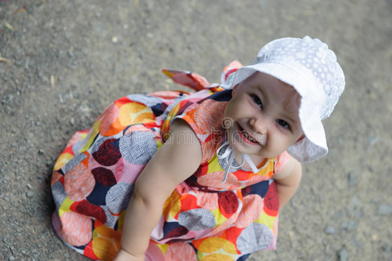 Cute baby girl in white hat royalty free stock photos