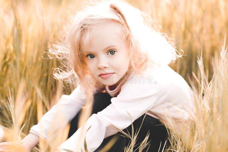 Kid girl outdoors stock photos