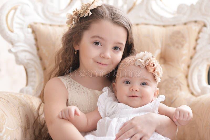 Cute baby girls posing stock photos