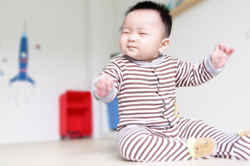 Cute Baby happy close his eyes stock photography