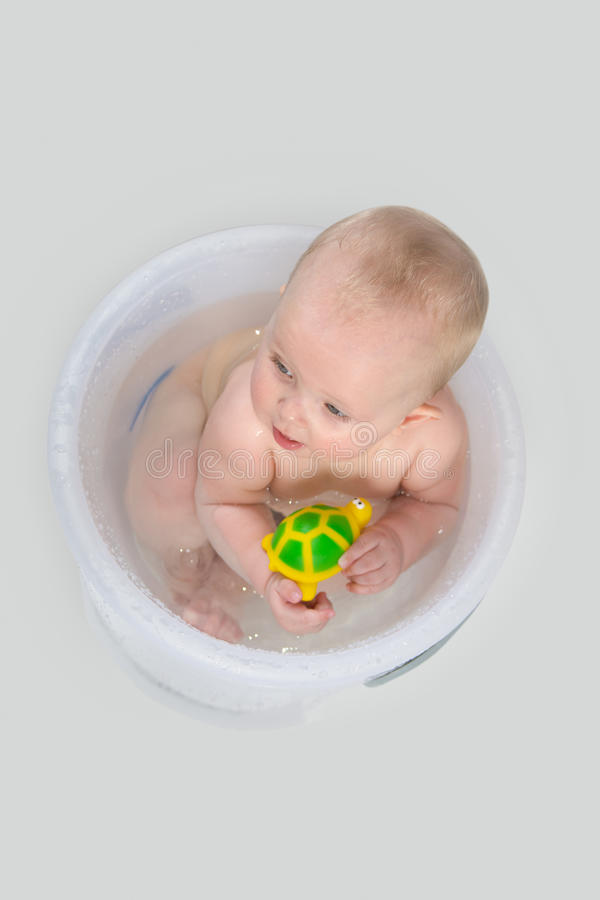 Cute Baby Having A Bath In Transparent Bucket And Playing Stock ...