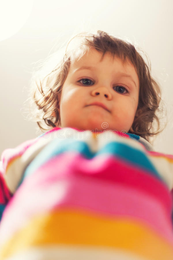 Cute baby looking down royalty free stock image