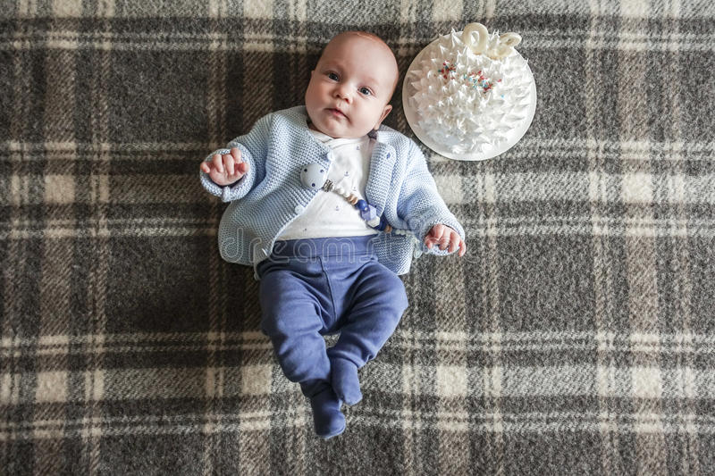 Cute baby lying on his back royalty free stock photography