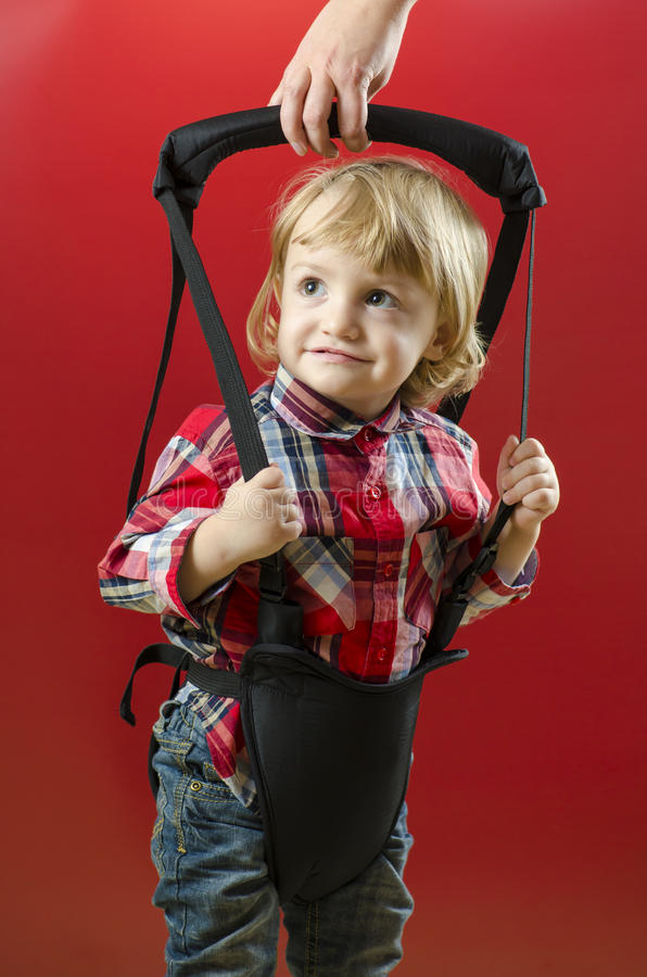 Download A Cute Baby Making His First Steps Stock Photo - Image: 28188644