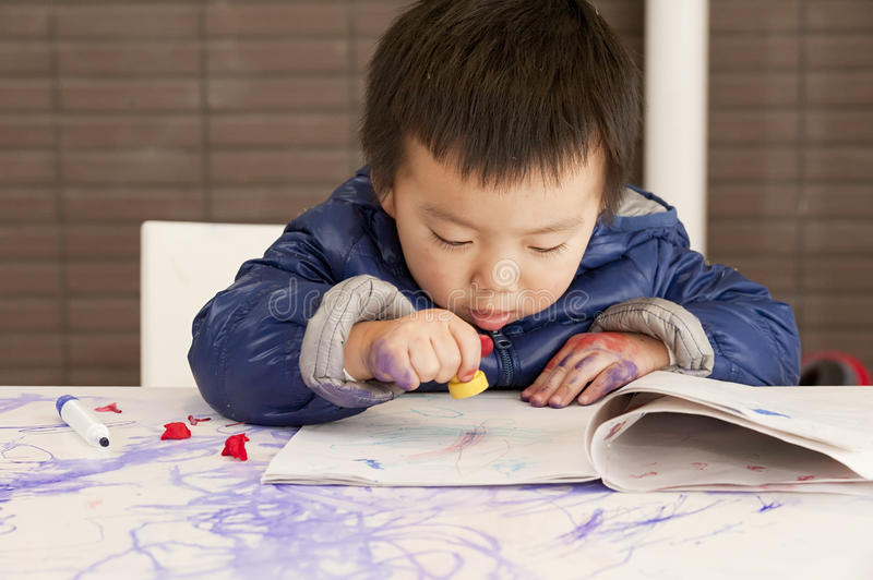 Cute baby is painting stock images