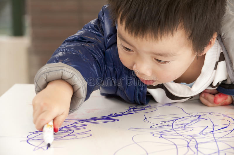 A cute baby is painting stock image
