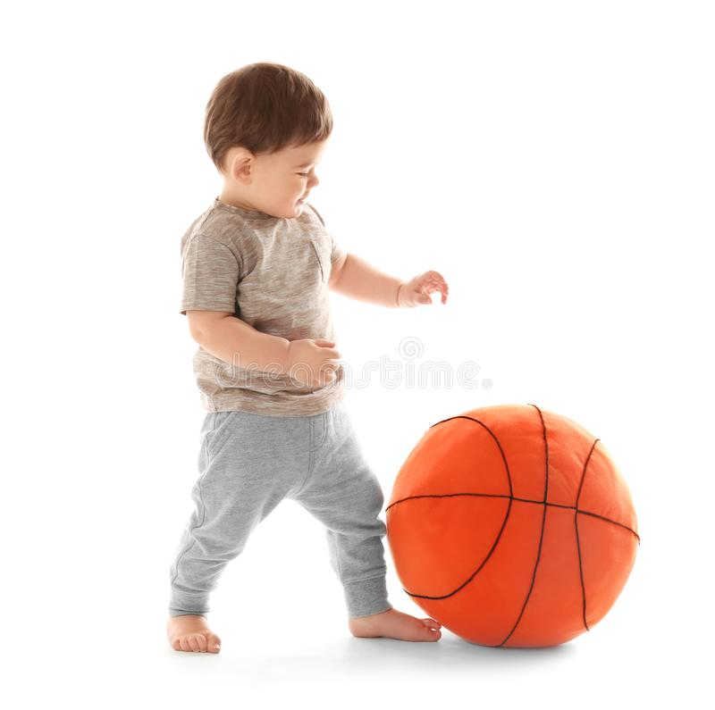 Cute baby playing with ball on white background. Learning to walk stock photography
