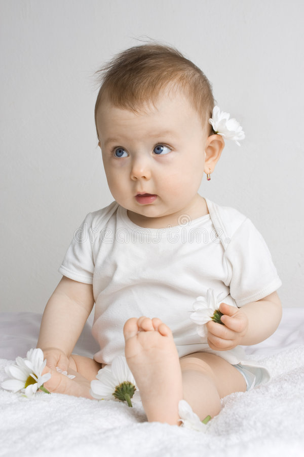 Download Cute Baby Playing With Flowers Royalty Free Stock Photos - Image: 5397338