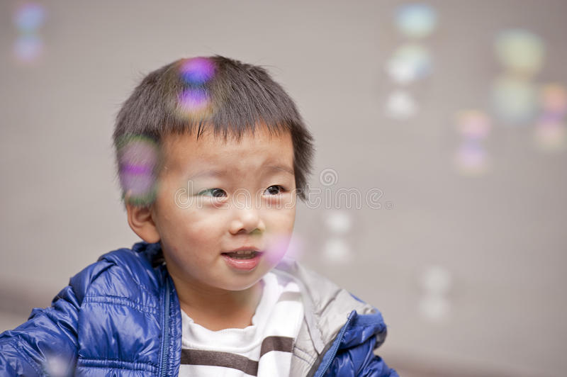 A cute baby is playing in a park stock photos