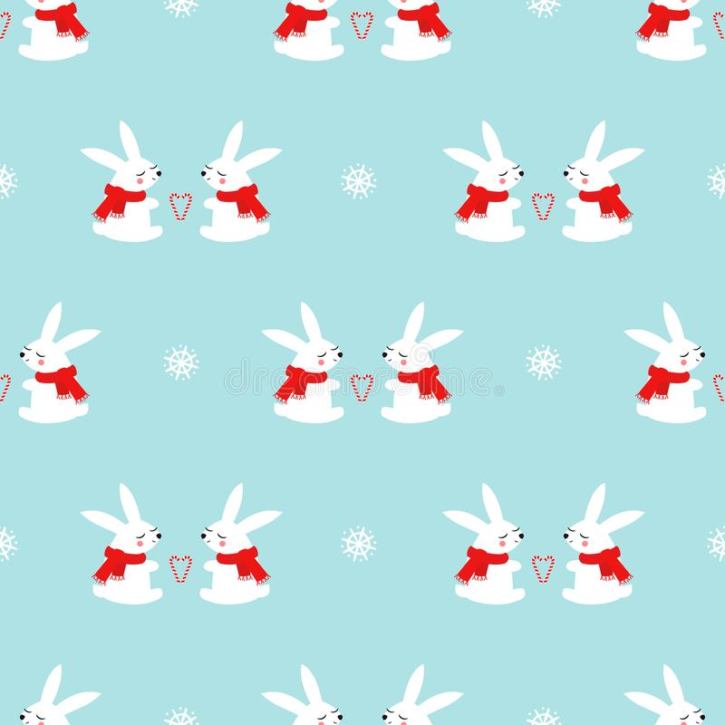 Cute baby rabbits with candy cane hearts and snowflakes seamless pattern on blue background. royalty free stock photos