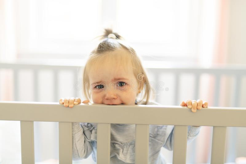 Cute baby baby on the baby room crib. A Baby on the baby room crib royalty free stock images